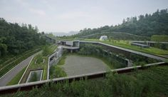 Completed in 2015 in Chongqing, China. Images by Su Shengliang, Xiaokai Ma. The community center is located in the mountains of Taoyuan Park in Chongqing. The starting point is attempting to merge new building outline with...