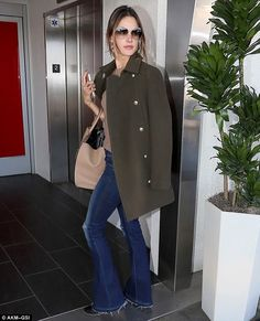 Alessandra Ambrosio.. Zadig & Voltaire Marlow Deluxe Coat, J Brand Martini Flare Jeans in Riot Destruct, and Gucci Jackie Bag..