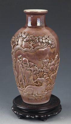 A FINE CARVED BROWN COLOR PORCELAIN BOTTLE Qing Dynasty, H:9.25 in × D:2.4 in