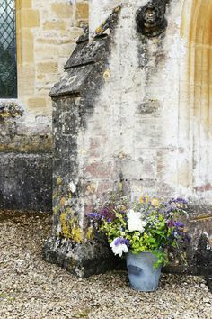 Bucket of flowers outside Great Barrington Church, Oxfordshire