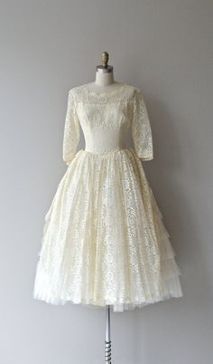 Vintage 1950s cream lace wedding dress with wide neckline, fitted bodice, 3/4 sleeves, fitted waist, gorgeous multi-layered lace skirt with two