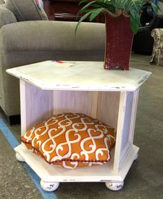Octagonal table repurposed to a pet bed for Habitat for Humanity Restore