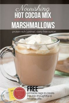 Nourishing Hot Cocoa with Honey-Sweetened Marshmallows - This treat is packed with nutrient dense ingredients such as mineral-rich coconut sugar, fermented raw cacao powder, and grass-fed collagen for a protein kick. Naturally primal with dairy free option. It also makes a great homemade gift with a FREE printable page for gift tags. #primal #nourishing #hotcocoa #homemadegifts via @preparenourish