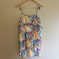 Layered Dress This bright colored, fun printed dress is perfect for the spring and summer. Julie Brown Dresses