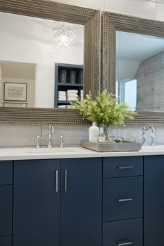 To mimic the double vanity, a pair of metallic framed mirrors add a decadent touch to the shared space.