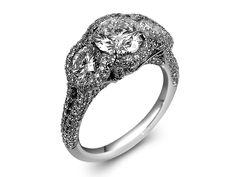 JB Star platinum #engagementring.  1.17ct round center diamond with a round diamond on each side weighing .77ct tw. #weddings #diamonds