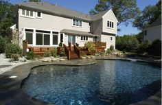Beautiful In-Ground Pool surrounded by Natural Stone