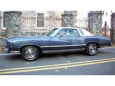 1977 Chevy Monte Carlo. My first car except in red with the same white top. :-)