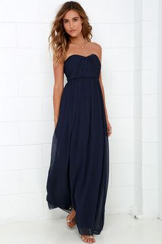 Every black tie event will be the perfect excuse to show off the Draw Her In Navy Blue Strapless Maxi Dress!  A strapless sweetheart neckline, complete with no-slip strip, tops a fitted bodice with lightly padded cups and angular seaming along the Georgette fabric. Elegant maxi skirt descends from the fitted waistline. Hidden back zipper with clasp. Fully lined in satin. Self: 100% Polyester. Lining: 95% Polyester, 5% Spandex. Dry Clean Only. Imported.