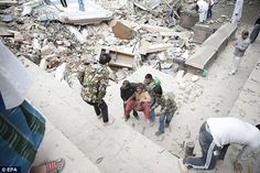 People carry a woman from the rubble of a destroyed building after an earthquake hit Nepal, in Kathmandu, Nepal Japan Earthquake, Image Shows, Destruction, Nepal, Mount Everest, Pictures, Travel, Outdoor, Photos
