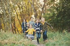 Kids aren't cooperating in your photo session?  Just let them run.  Happy smiles are guaranteed, and you will capture their playfulness.  125 Family & Sibling Photos: Posing Ideas & Inspiration.  #poses #photography #harvardhomemaker