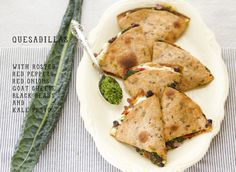 Quesadillas with goat cheese, black beans, red onions, roasted red peppers and kale pesto. Yum!