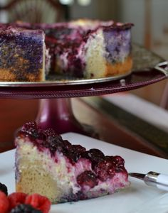 Look at those luscious berries and cream cheese filling. The perfect treat for the end of a hectic week! My whole family loves this and so will you! You can pour the berry sauce on before baking or you can add it after baking. Both are delicious!