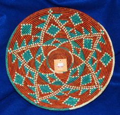 """A beautiful finely woven basket. 14"""" dia with a 3"""" depth. Perfect for party snacks or fruit, but so pretty, you can hang it on your wall as a decorative accent piece! $24.95 #basket #handwoven #homedecor"""