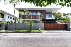 a_collective completed the design and development of Sunset Terrace House, a highly modern residence organized in an L-shaped plan in Singapore.