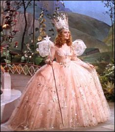 Glinda (Billie Burke) who played the good witch from the North in the movie The Wizard of Oz.  The dress was created by Adrian, the head costume designer at MGM.