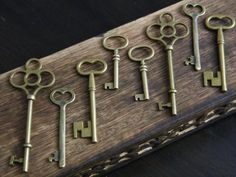 I WANT THESE!!!!!!!!!! Keeper of Keys 8 Antique Bronze Brass Skeleton Keys by thejourneysend on Etsy