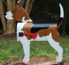 This unique mailbox will definitely be a conversation starter for any Beagle or dog lover!    A wooden dog structure is built around a steel,
