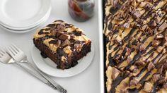 Peanut Butter - Chocolate Poke Cake - Betty Crocker™ SuperMoist™ chocolate fudge cake mix, creamy peanut butter, chocolate syrup and a classic candy come together to make this crowd-pleasing poke cake.