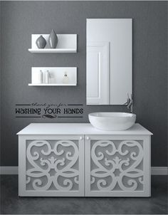Grey and White bathroom wall decor. Really thinking about re-doing the bathroom grey and white. Love this color