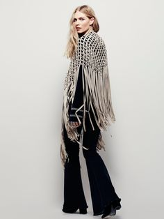 Heart of Gold Fringe Shawl   Vegan suede macrame shawl featuring statement fringe trim. With metal bead accents.