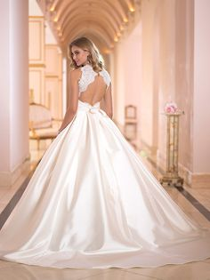 OMG in love with this unexpected open lace back on this classic ballgown! Stella York available at Lilla's Bridal   Pin from DreamWeddingsPA.com