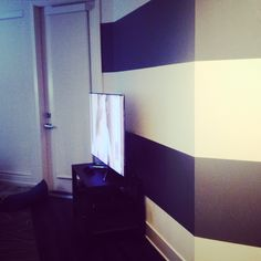 Accent a wall with stripes. Grey stripes.