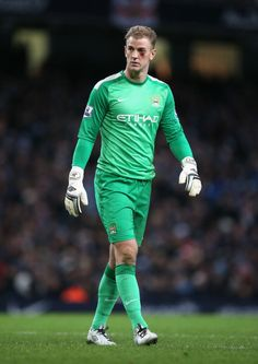 Joe Hart of Manchester City looks on after sustaining an eye injury... News Photo 459591945
