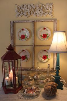 love the plates in the old window frame and the blue lamp