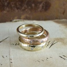 Beaten diamond set wedding rings by Alexis Dove #eternityrings #beatengold #hammeredgold #handmade