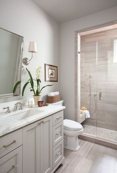 white and neutrals basement bathroom More