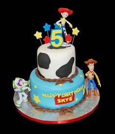 5th Birthday Cow print and stars 2 tiered cake with Toy Story figurines by Simply Sweets, via Flickr