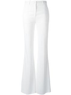 Pantaloni de damă ROBERTO CAVALLI, eleganți, confortabili, mulați, din bumbac, model fashion, slim fit, evazați, cu talie ridicată, închidere cu fermoar ascuns și buton central.