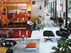 Charles and Ray Eames in their own home.  What a rich and colorful home they created together.  Love the use of ethnic objects.