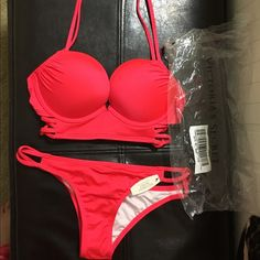 Victoria secret bombshell bathing suit Brand new in the package with tags! Victoria Secret add two cup size push-up top and strappy Itsy bottom. Top is a 32-B and bottoms are a size Small. Victoria's Secret Swim Bikinis
