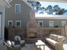 Back Patio with Brick Fireplace: Pearce Scott Design under prior association