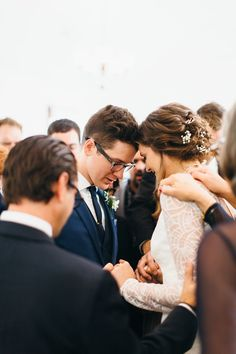 I want to have our close family, friends, loved ones surround us and pray over us at our ceremony after our vows and before or after worship