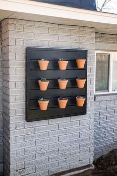 Are you looking for an easy woodworking project to start off your garden or backyard makeover? Then this is for you! Learn how to make this easy wood wall to hang a vertical pot garden! #wood #DIY #garden #projects Outdoor Plants, Outdoor Walls, Outdoor Living, Diy Garden Projects, Garden Ideas, Wood Projects, Outdoor Projects, House Projects, Outdoor Ideas