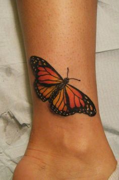 Ladies love butterflies. Tattoo by Eric Bradley Bullock #Inked Magazine #butterfly