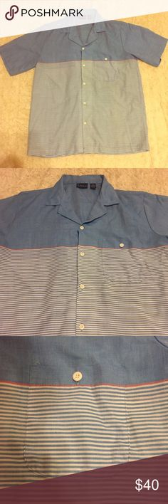 Unique VTG  Levi's Blue Striped Short Sleeve Shirt Men's Unique VIntage Levi's Blue Solid and Multicolored Striped Short Sleeve Button Shirt. Tag says Medium but would fit a Large too IMO. Comment if you need measurements. White Buttons up the front and one on the breast pocket. If a mans shirt can be pretty this one is. In excellent condition as well. Buy before someone else scoops up! Bundle and Save $ For every four items you buy you get one under 10$ free! Vintage Shirts Casual Button…