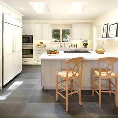 Gray tile floors + white kitchen cabinets
