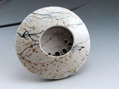 Polymer clay, brass detail. By Stonehouse Studio
