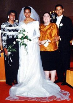 Barack Obama and Michelle Robinson's wedding photo featuring Mrs. Robinson and Barack's mom.--flowers