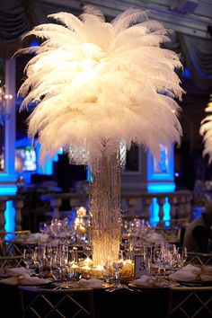 oversized feather centerpiece - make a bold impression with monochromatic feather centerpiece