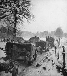 Vehicles and infantry of the US 1st Army on the road during winter fighting in the Ardennes forest conflict known as the Battle of the Bulge