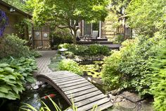 Koi pond in Downers Grove, IL creates unique outdoor living space. This ecosystem pond with garden has appeared in Better Homes and Gardens. Installed by Aquascape Designs. Backyard Water Feature, Ponds Backyard, Koi Ponds, Pond Bridge, Garden Bridge, Pond Landscaping, Landscaping With Rocks, Chicago Landscape, Zen