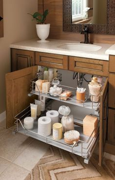 Brilliant way to organize under the sink in a small bathroom.  2 organized pull out shelves give a lot more space of organization and storage