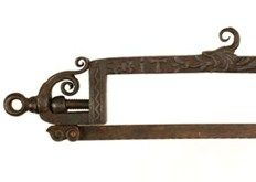 A rare example of a heavily decorated English tool, this early 18th century armourer's saw took £2000 at the same sale.