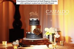 Soundwave just loves the classic sophistication of black, white and gold. Timeless and oh-so glamourous!  Reception at Hyatt Regency Orlando Cake by Party Flavors Custom Cakes Design by The Soiree Co. Photo by CastaldoStudio.com Gallery LED Lighting by Soundwave Entertainment, djsoundwave.net