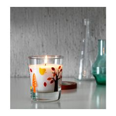 TIMGLAS Scented candle in glass IKEA Extinguish the candle by putting on the lid, which closes the scent in too.